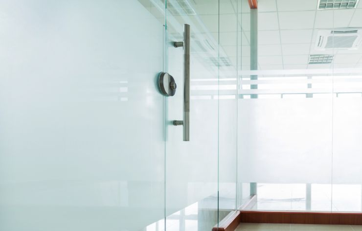 Commercial glass in office with white out film | Demers Glass AZ