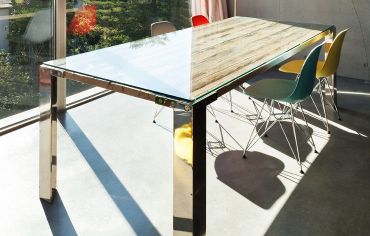 Custom glass conference table in bright sunlight | Demers Glass AZ