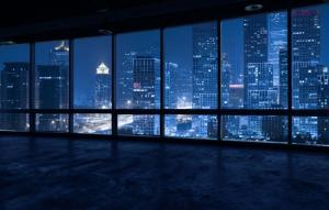 Empty office building look out at city skyline | Demers Glass AZ