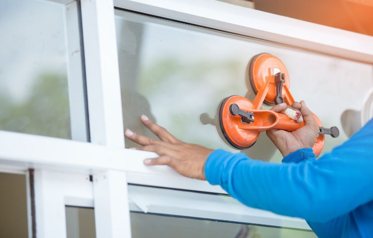 Glazier replacing residential window | Demers Glass AZ