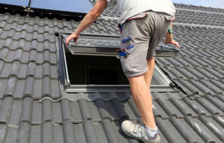 Technician installing a new skylight on a roof | Demers Glass AZ