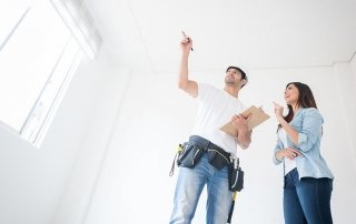 Contractor providing a window replacement estimate to a homeowner | Demers Glass